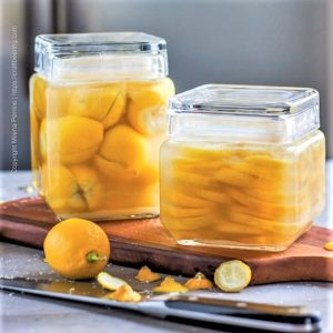 Preserved lemons in jars - quartered and sliced versions.