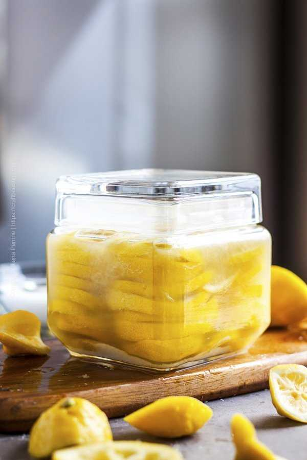Sliced preserved lemons in glass jar with air tight lid.