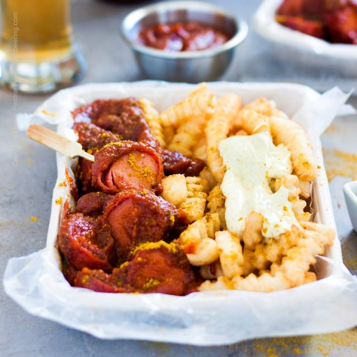 Currywurst, slices and smothered with curry ketchup and served with fries and mayo.