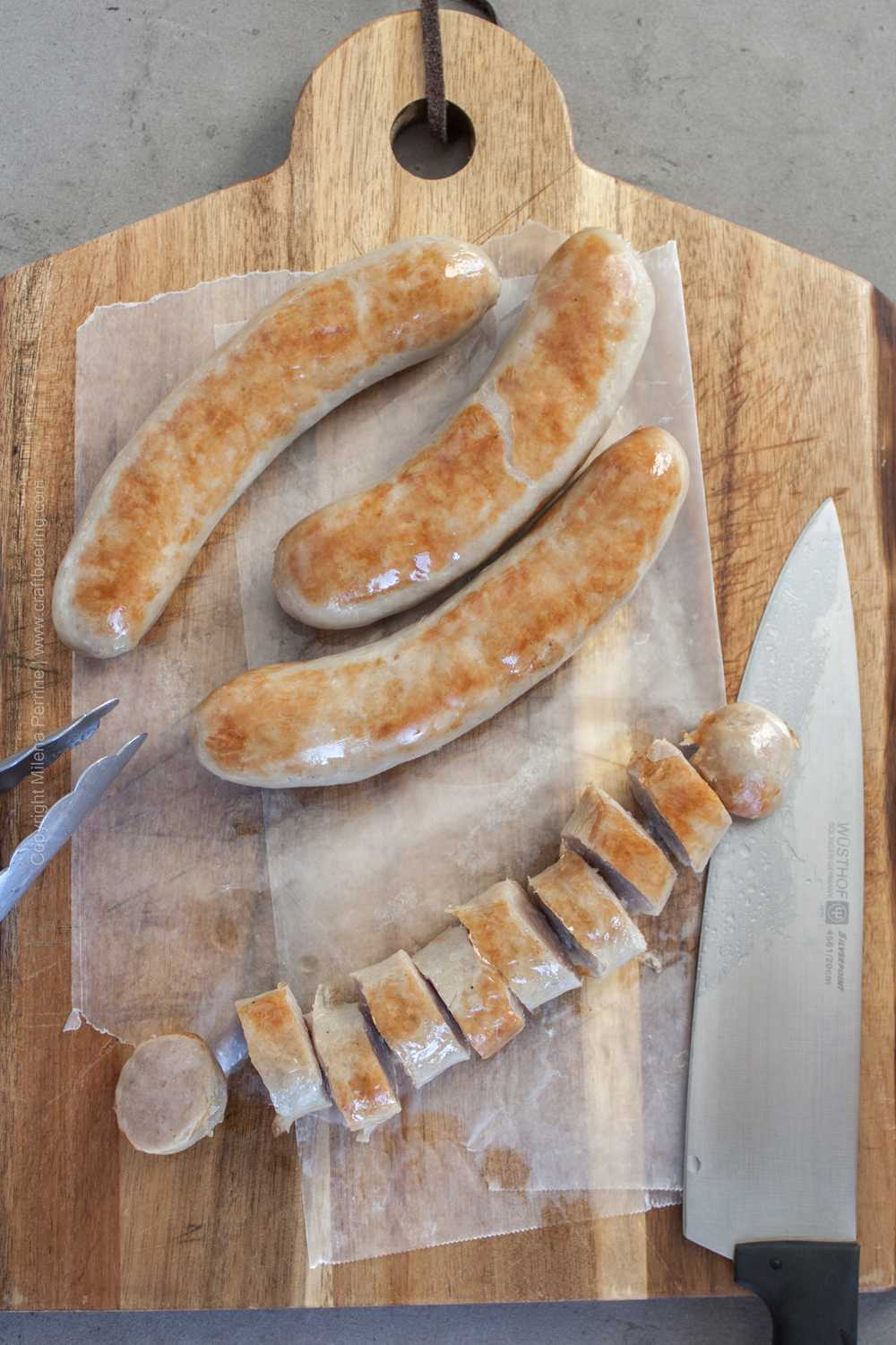 Bratwurst already blistered up from pan-frying, appropriately sliced and ready for curry ketchup