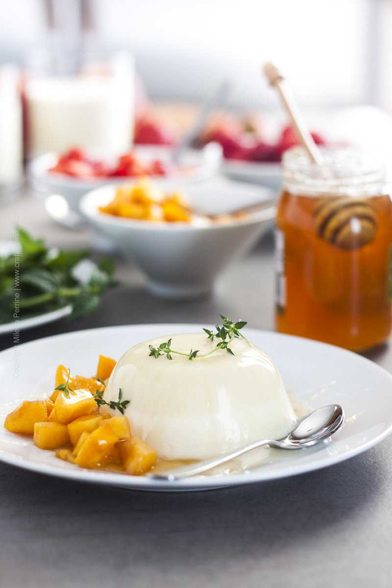 Bavarian cream dessert - unmolded and served with diced peaches, honey and thyme.