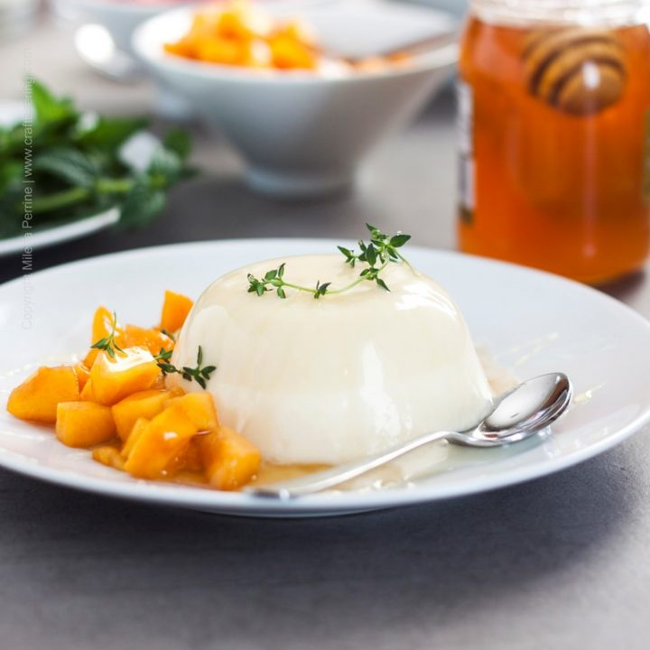 Bavarian cream unmolded and served with diced peach, honey and thyme.