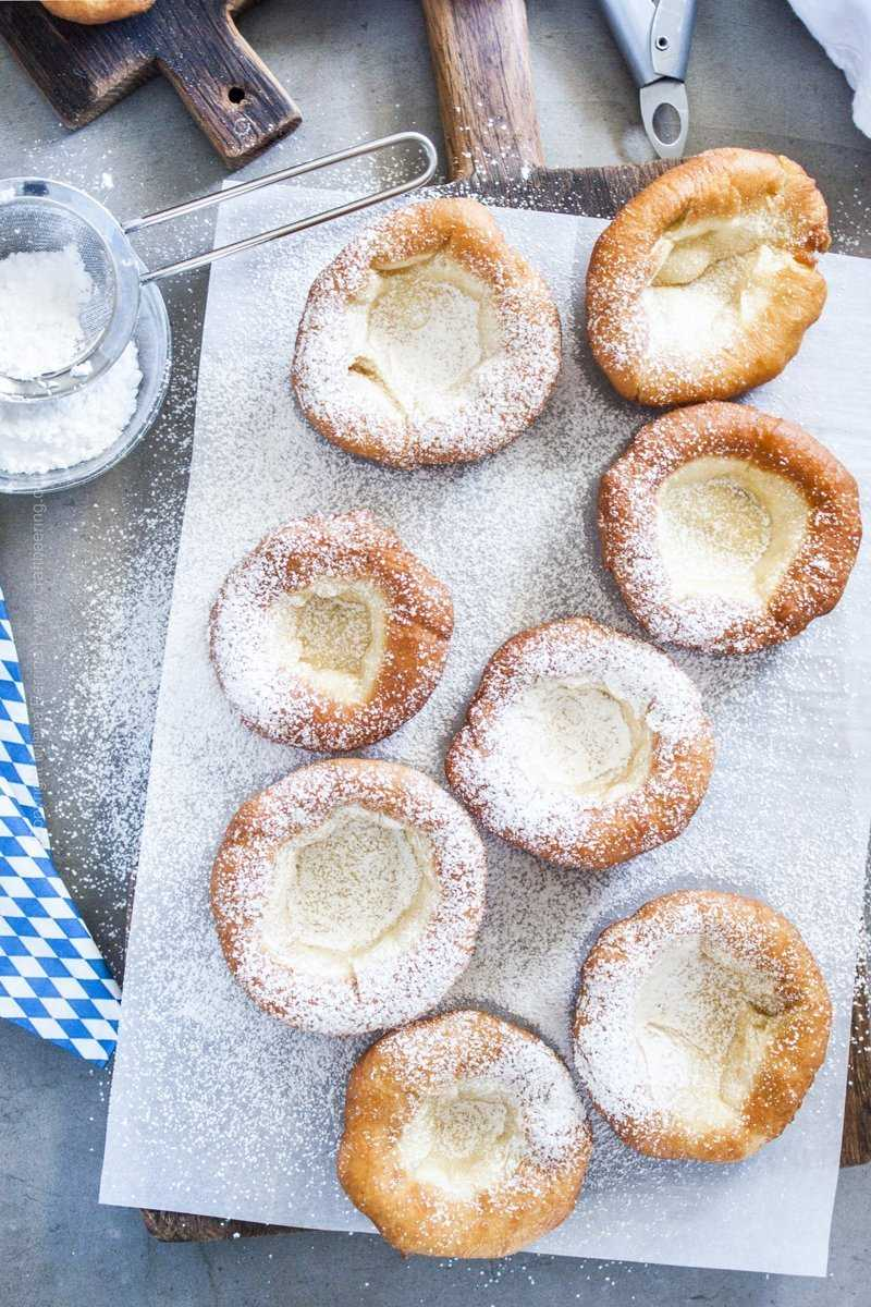 Traditional Bavarian donuts dusted with powdered sugar.