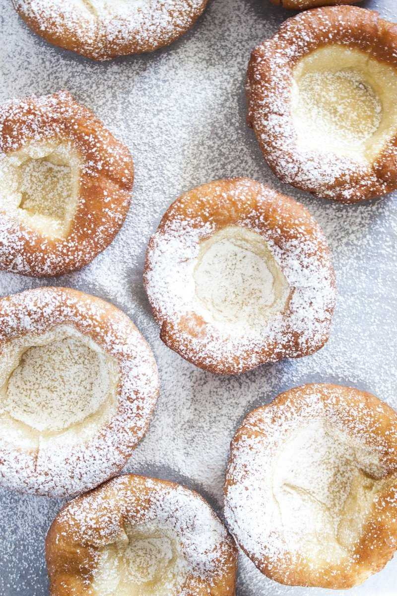 Bavarian donuts with powdered sugar.