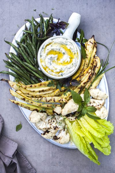 Herbed ricotta dip topped with extra virgin olive oil and served with vegetables.