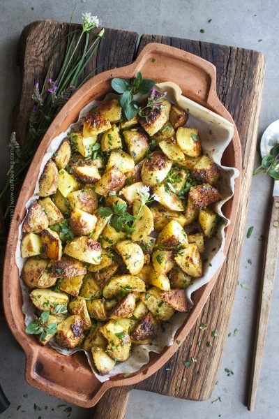 Crispy oven roasted potatoes with garlic and fresh herbs.