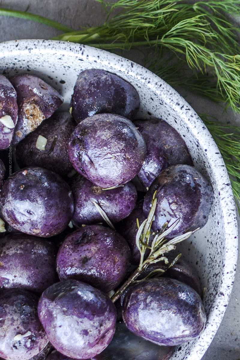 Whole, skin on purple potatoes cooked in butter, beer, garlic and rosemary.