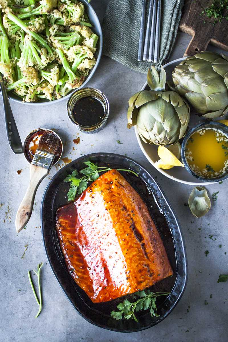 Irish whiskey glazed oven baked salmon fillet served with artichokes and baby cauliflower.