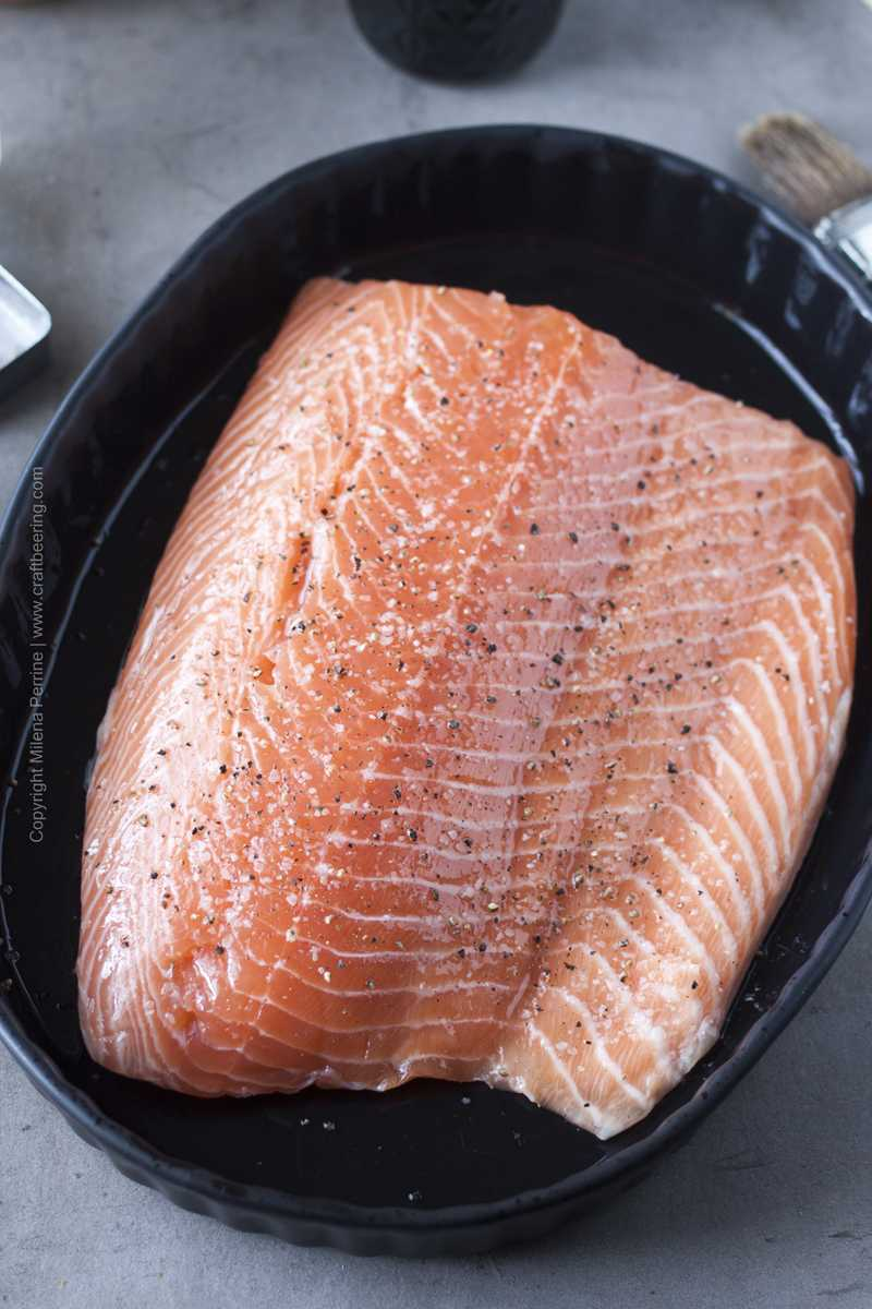 Salmon fillet lightly brushed with olive oil and well seasoned with salt and pepper.