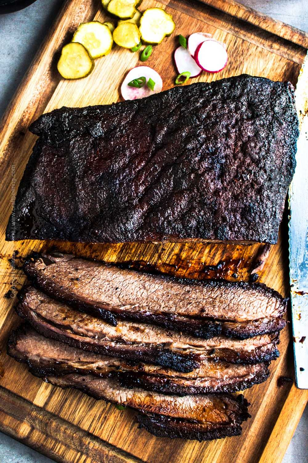 Braised beer brisket on cutting board
