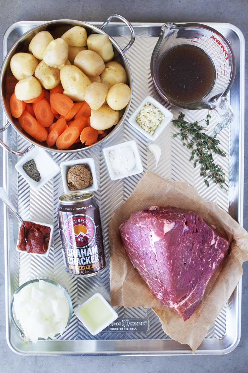 Ingredients for porter pot roast with rump beef, potatoes, onion and carrots.