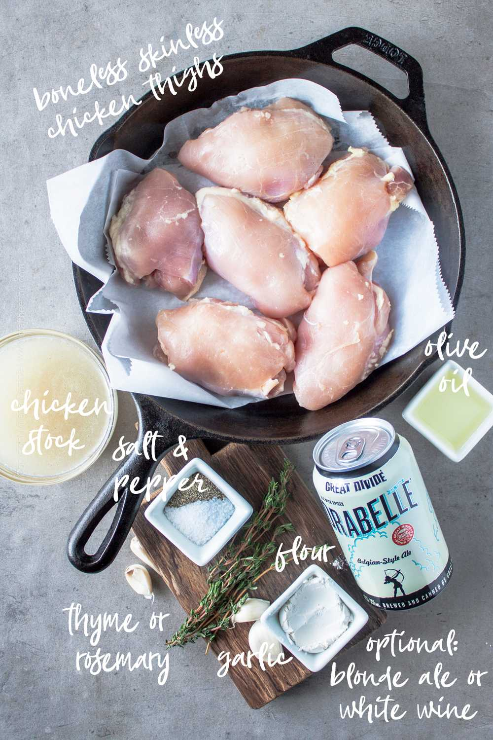 Basic ingredients for oven or stove top boneless chicken thighs in cast iron skillet.