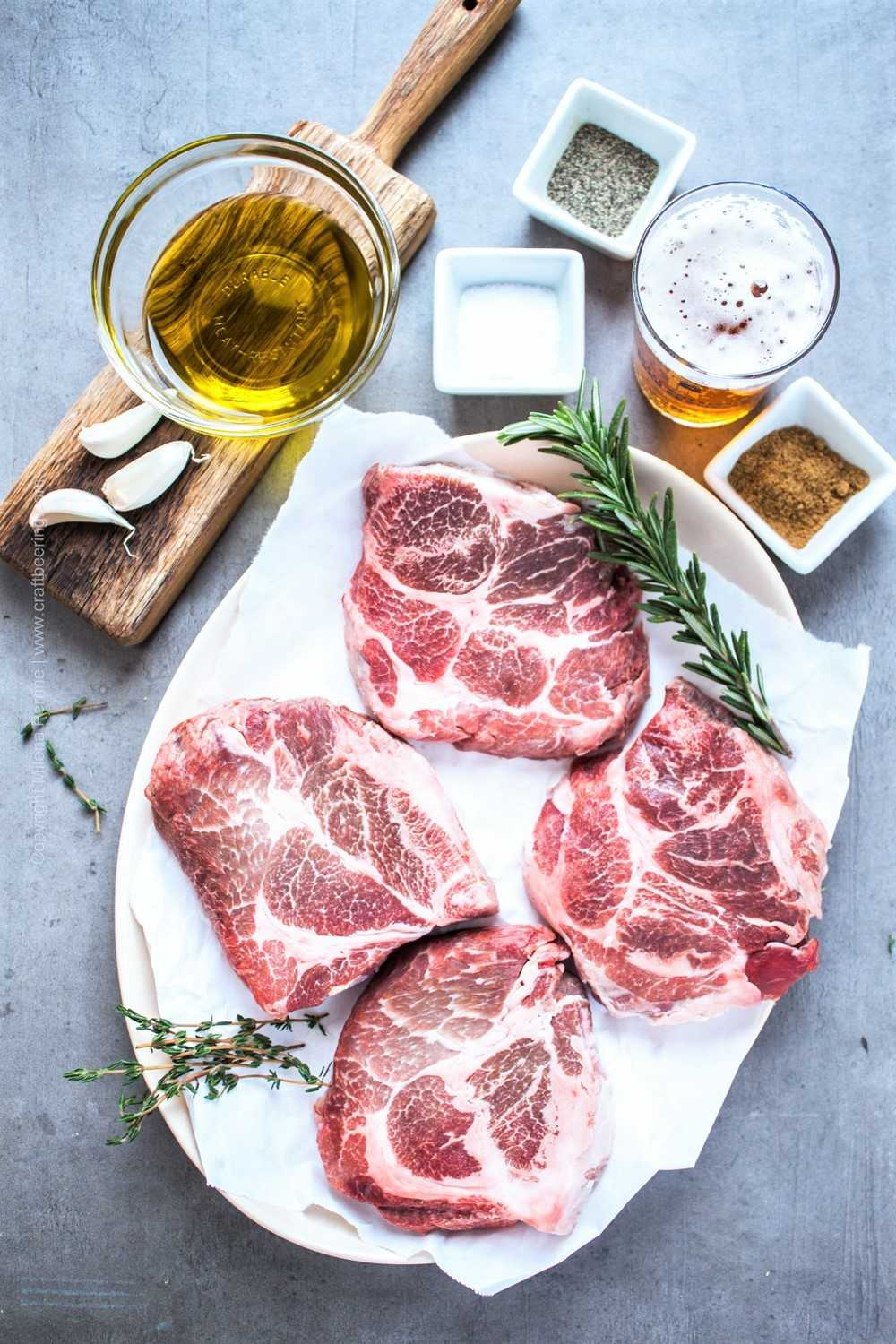Raw pork neck chops and ingredients for pan searing.