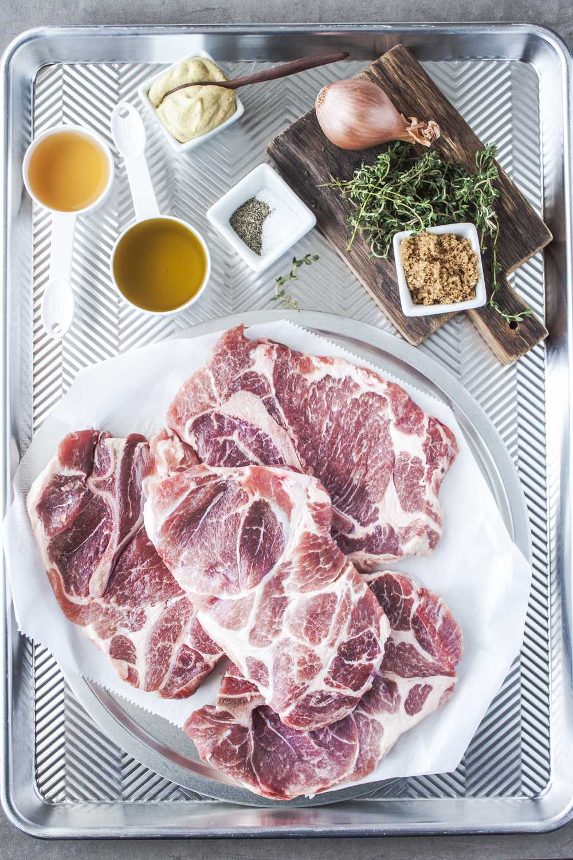 Ingredients for baked pork shoulder steaks.