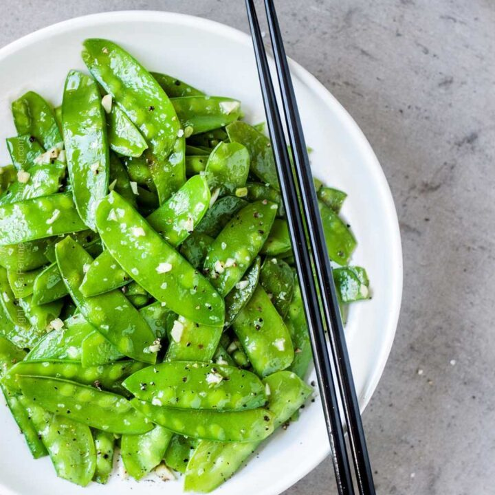 Easy skillet snow peas with olive oil, garlic, sea salt and pepper.