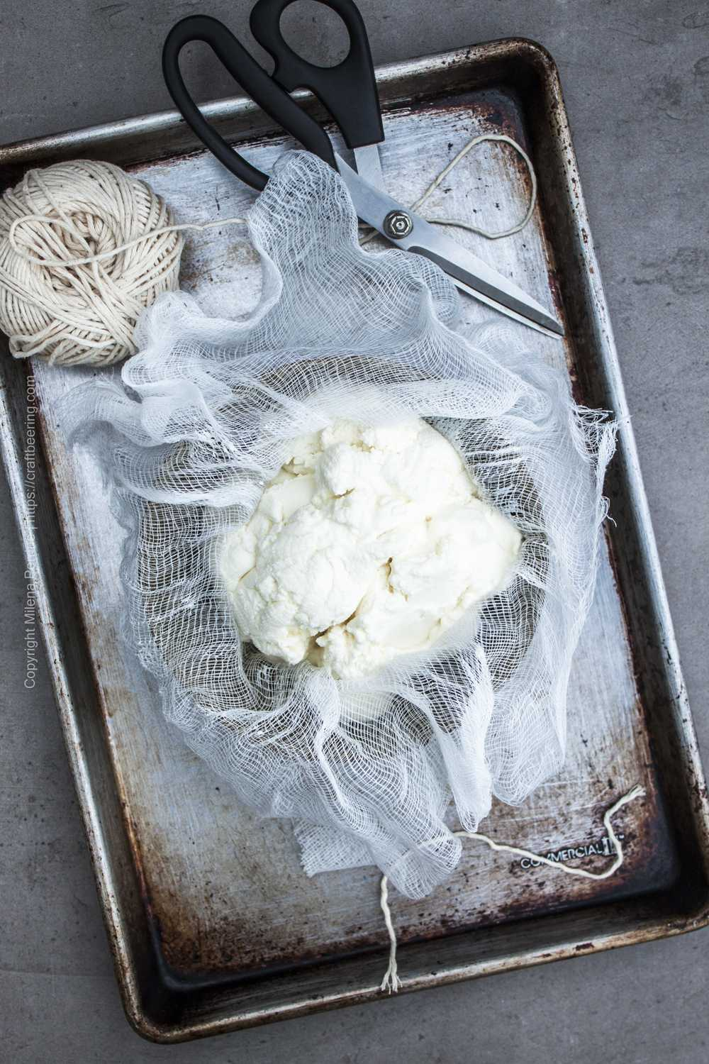 Fresh ricotta, cheesecloth, butcher's twine and other items needed for smoked ricotta.