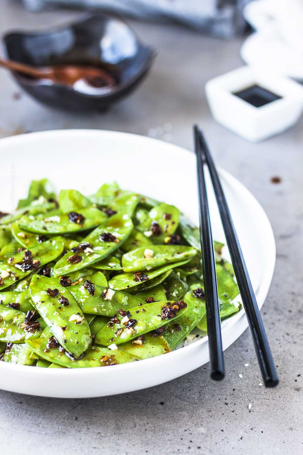 Sauteed snow peas tossed in Asian chili oil.