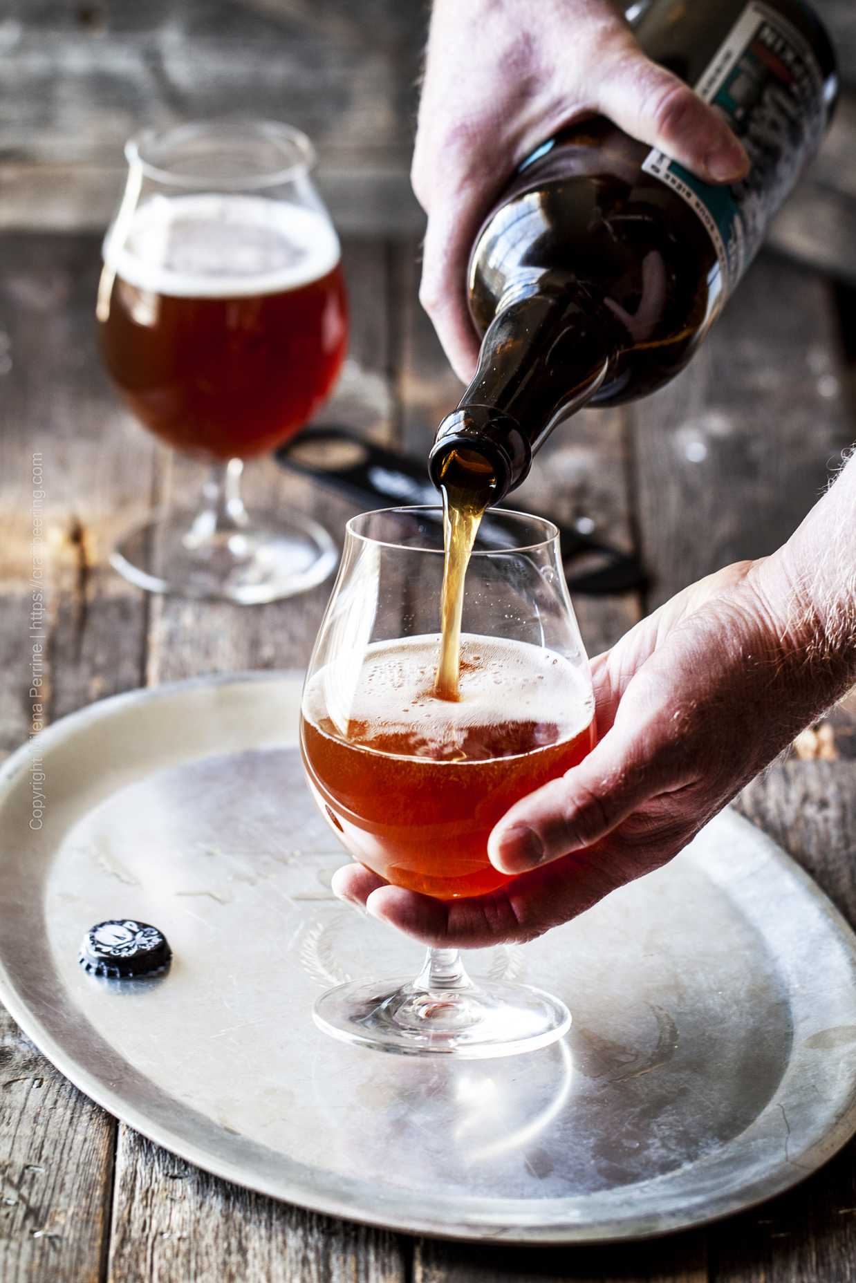 A unique, limited edition wild ale in the Flanders style from the Rare Beer Club being poured into a glass.