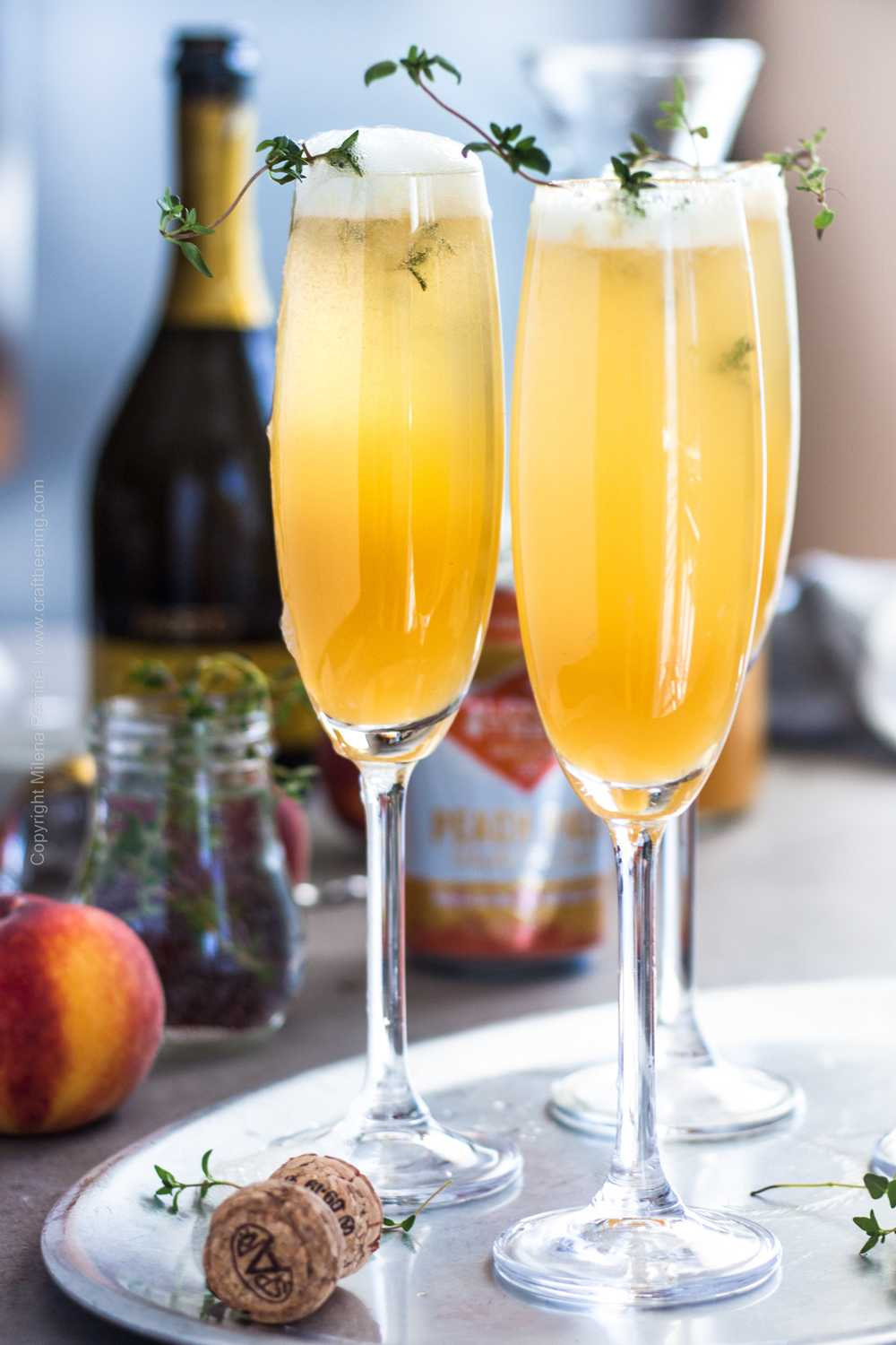 Peach Bellini Drink made with fresh peach puree, peach ale and prosecco
