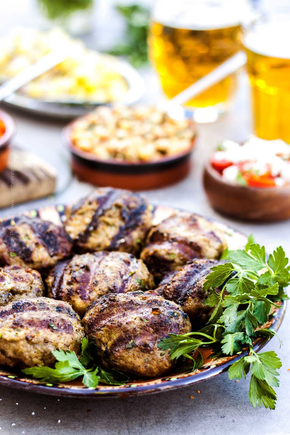 Kafta served on platter with various side dishes.
