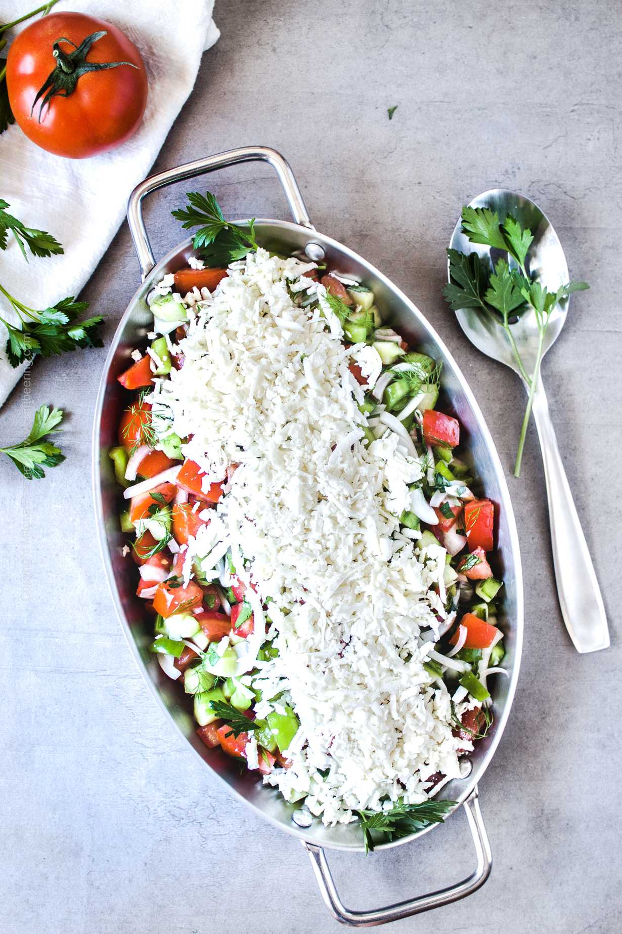 Vibrant tomato cucumber salad with feta cheese.