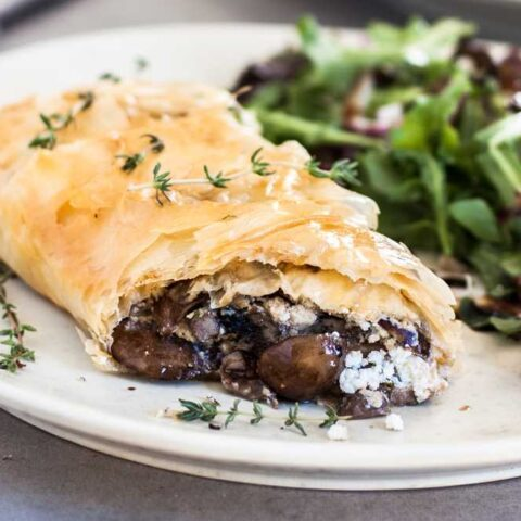 Goat cheese mushroom strudel with thyme and red leaf salad.
