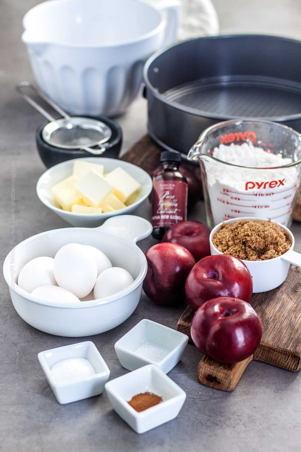 Ingredients for plum cake - eggs, sugar, flour, fresh plums, butter