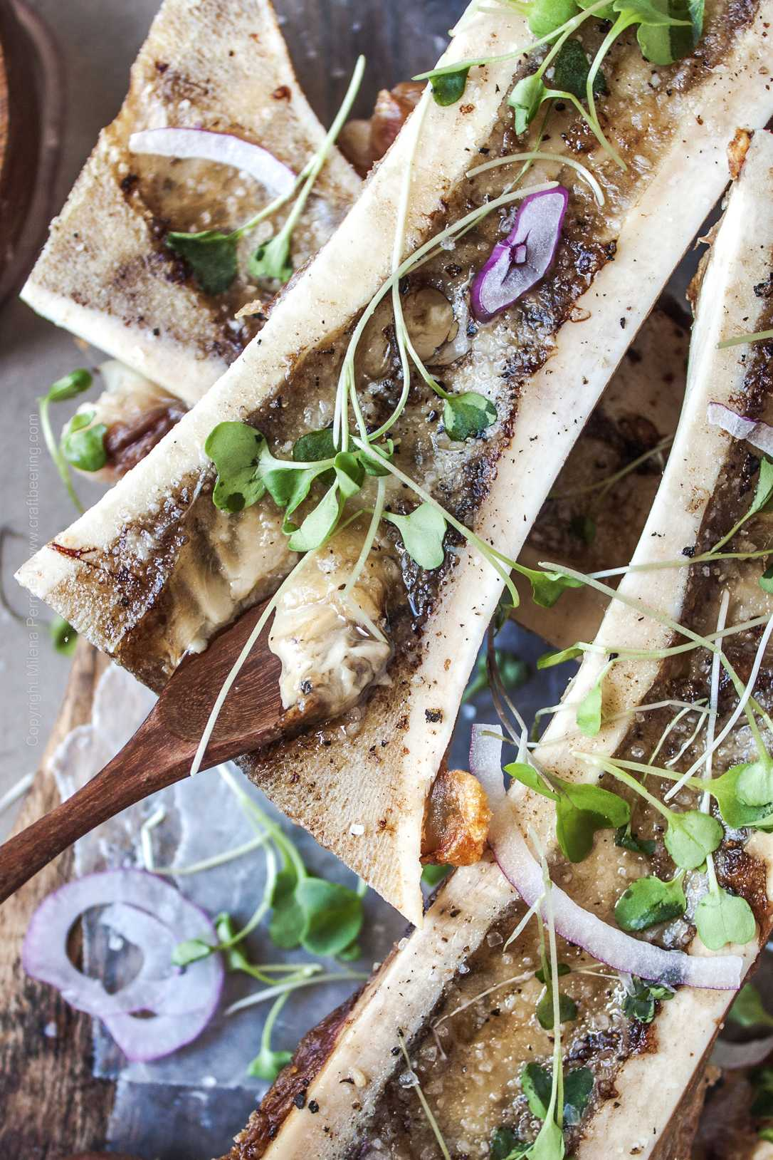 Roasted bone marrow is easily scooped with a small spoon. It's spreadable texture is perfect for toast or freshly baked bread.