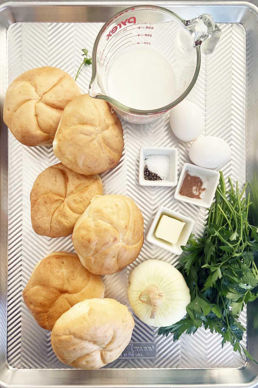Kaiser bread rolls, milk, onion, eggs, butter, parsley, nutmeg and salt and pepper - needed to make semmelknodel.
