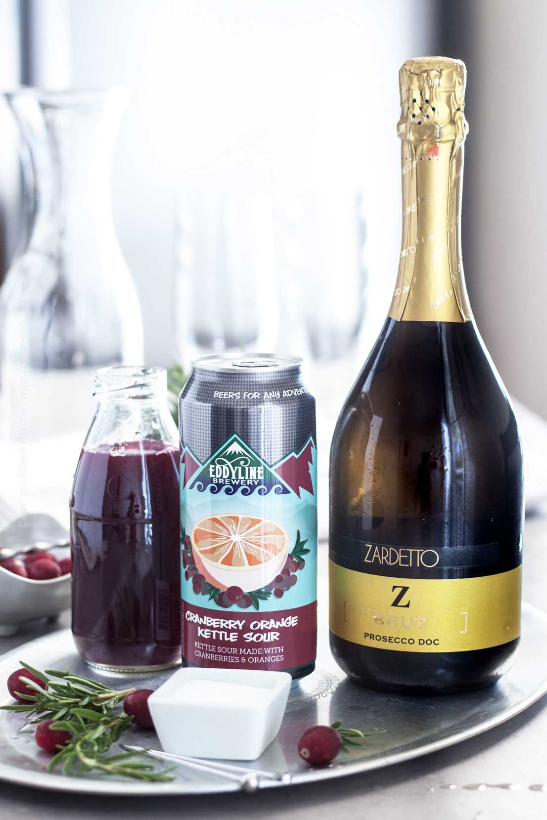Ingredients for a prosecco cocktail with cranberry