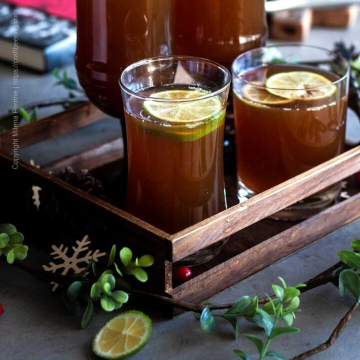 Holiday beer punch drink with ginger ale, lime juice and orange peel