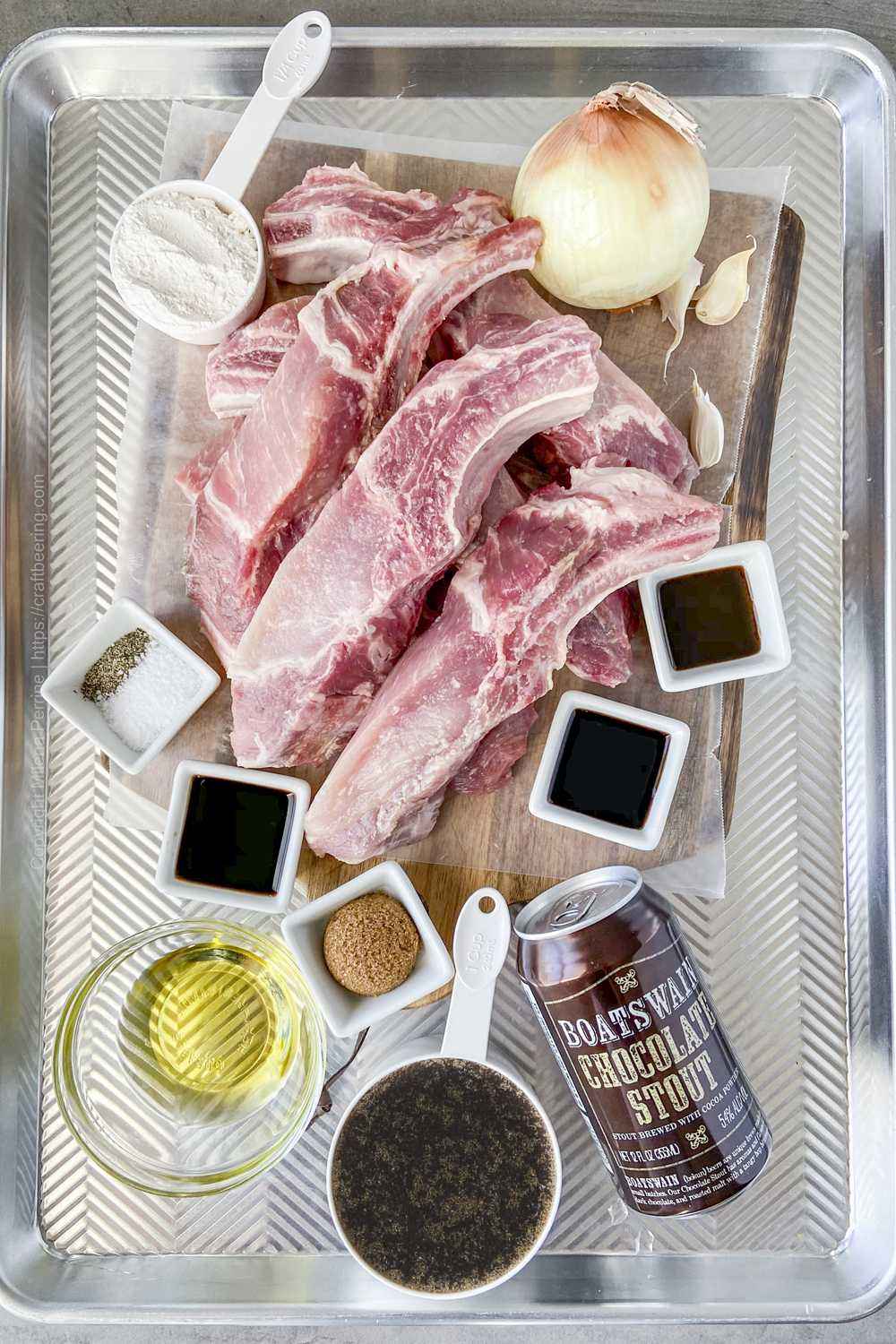 Raw country style ribs (bone-in) and other ingredients needed to braise them.