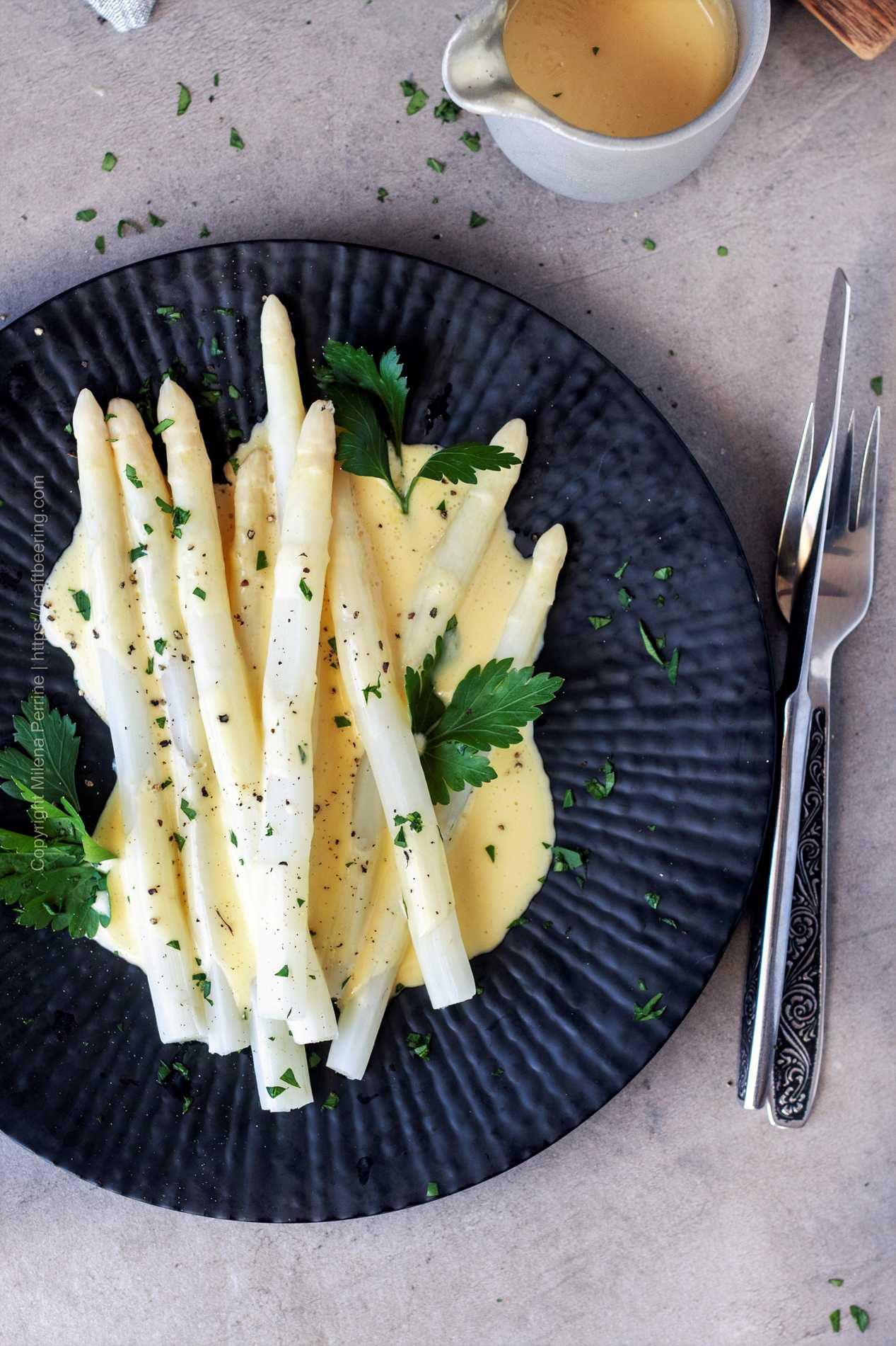 Plated white asparagus with Hollandaise - a classic German recipe, popular during spargelzeit and beyond.