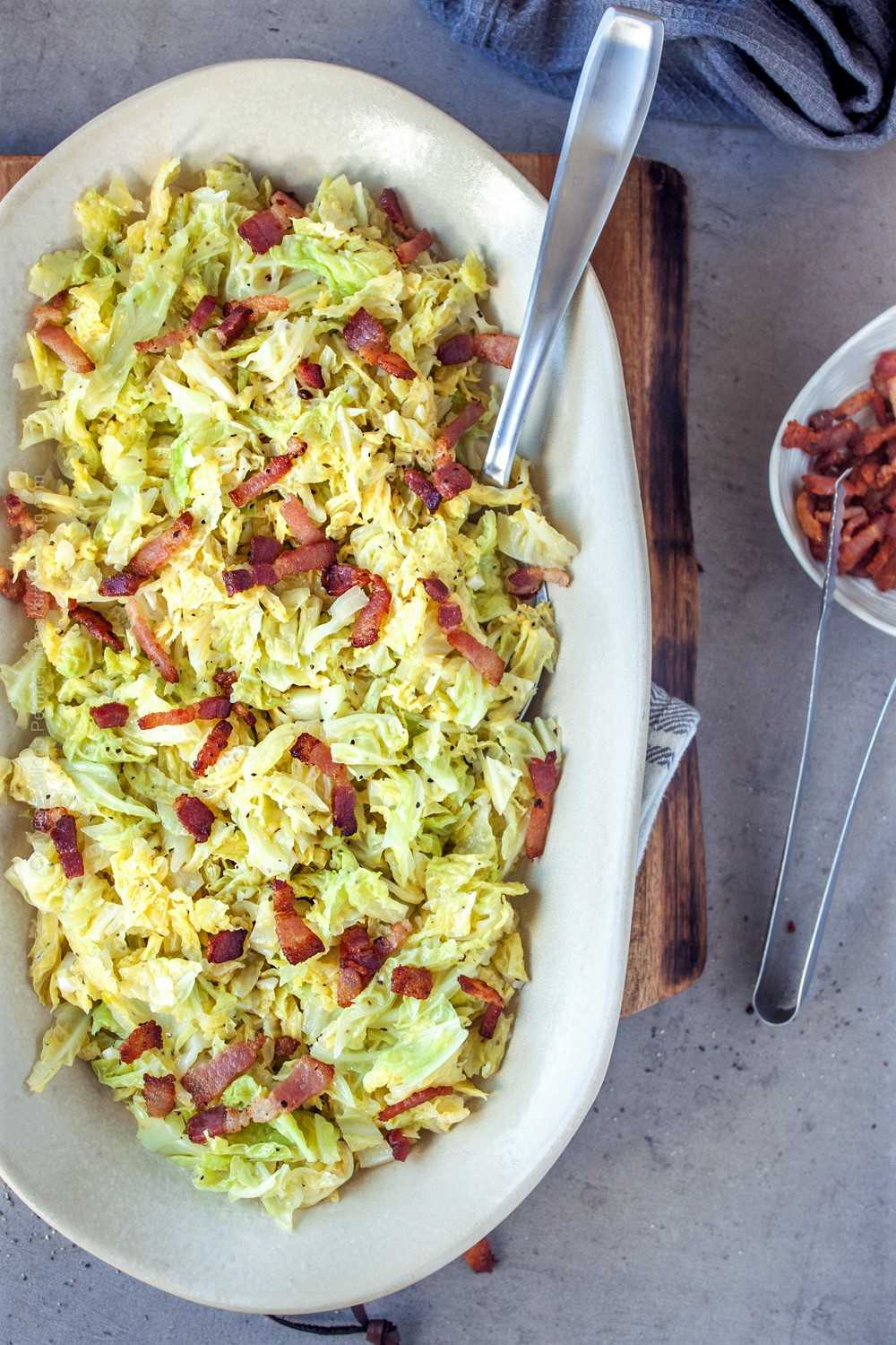 Platter with savoy butter cabbage presented with crispy bacon bits for extra flavor.