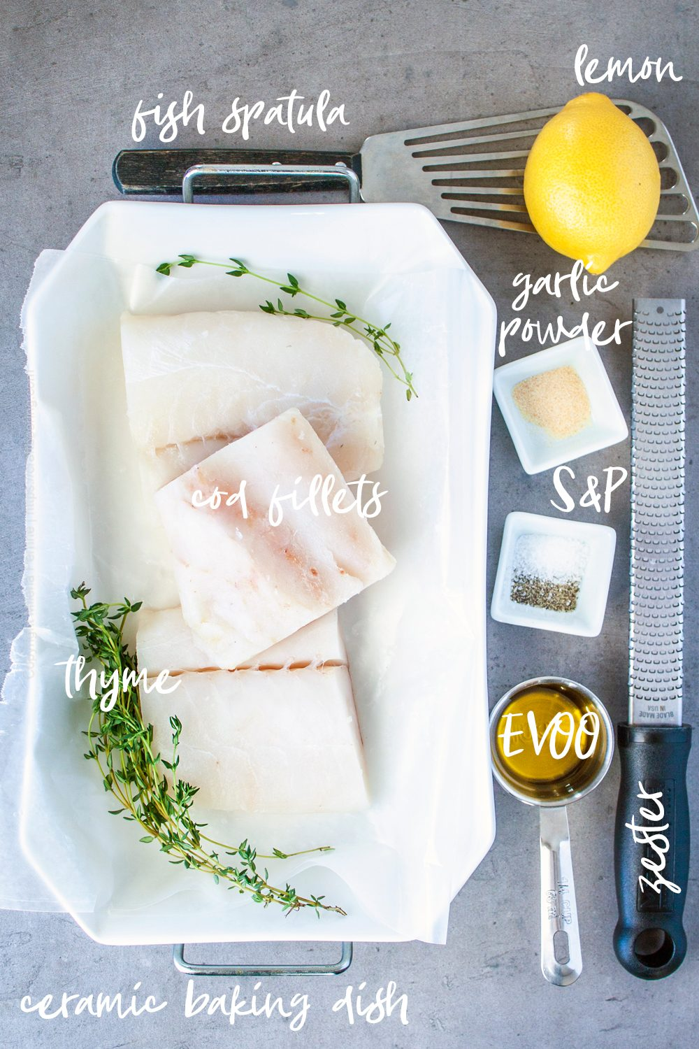 Raw cod fish fillets, lemon, thyme, olive oil and seasonings. Everything needed for this baked cod recipe.