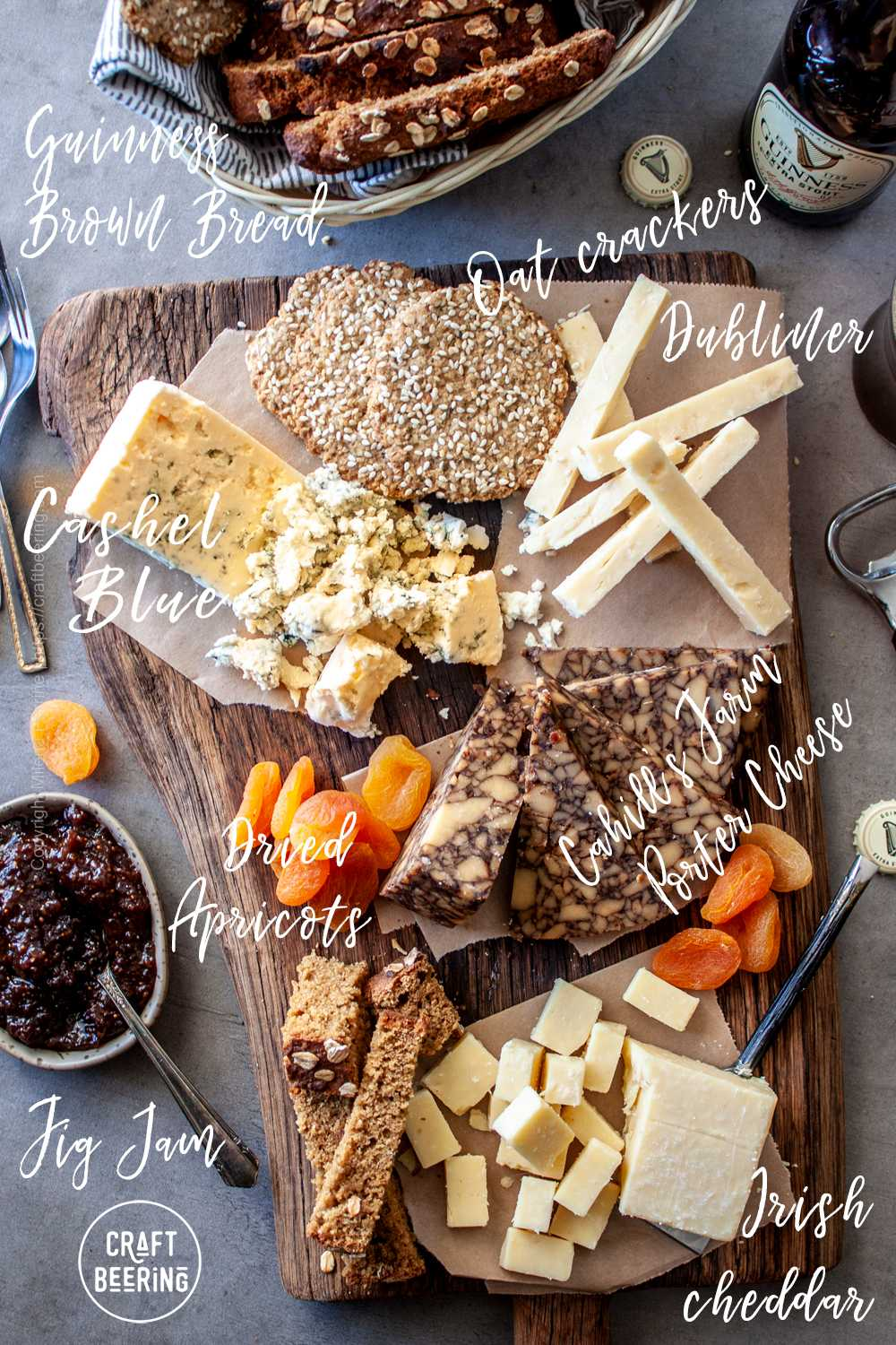 Irish cheese board with Cashel blue, Dubliner, Irish cheddar and Cahil's Farm cheddar with porter, accompanied by dried apricots and fig chutney.