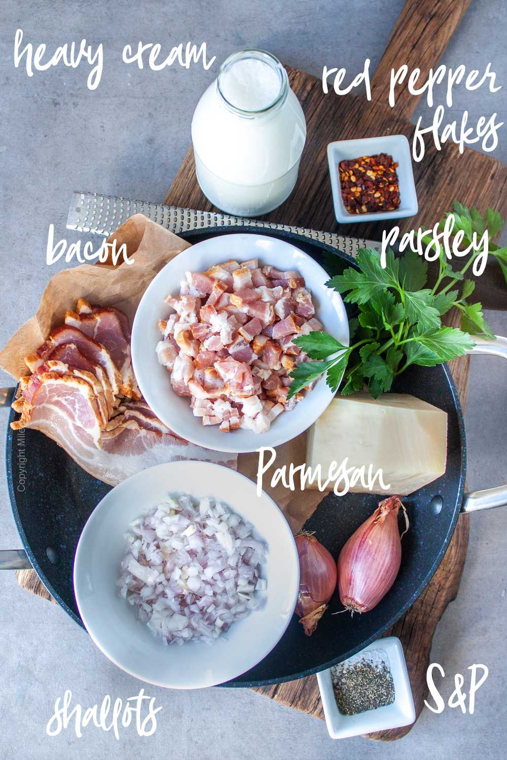 Bacon, shallots, heavy cream and other ingredients needed to make beacon cream sauce.