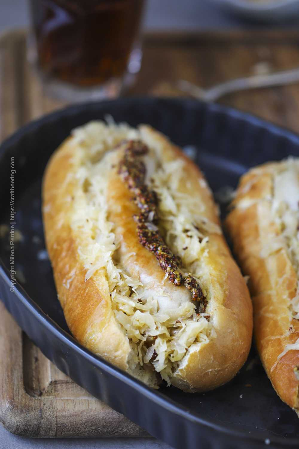 Beer braised sauerkraut and bratwurst on a bun.