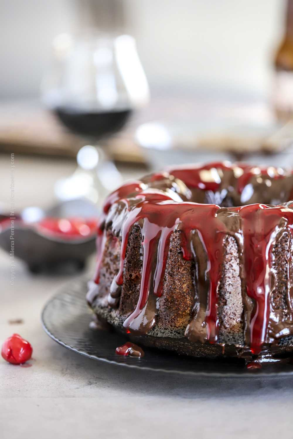 Cherry chocolate bundt cake topped with cherry pie filling juice and chocolate ganache.