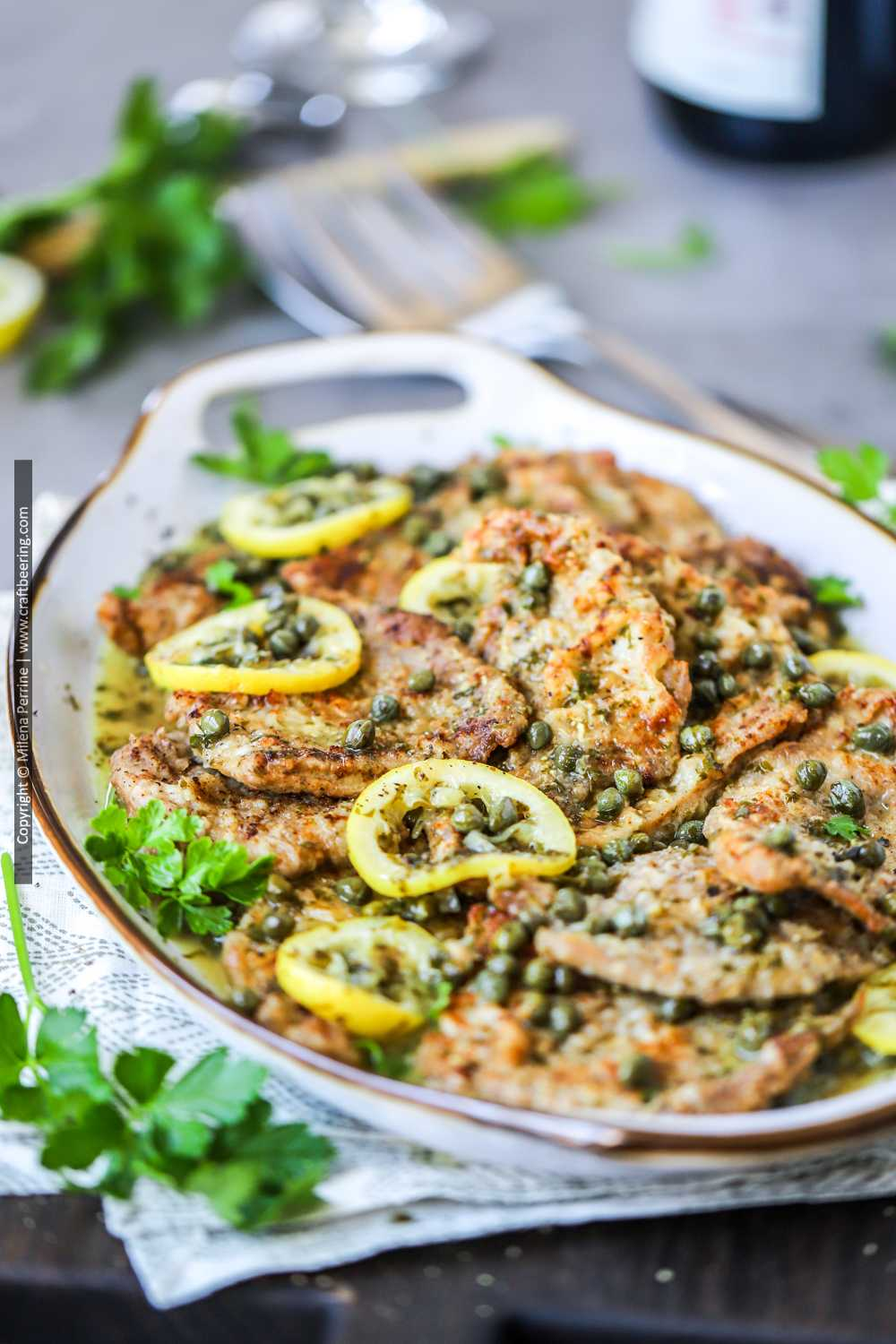 Scallopini of veal piccata served on a platter.