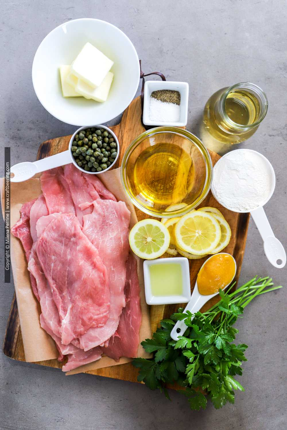 Raw veal scallopini and ingredients for piccata sauce.